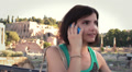 Beautiful woman talking on cellphone near Roman forum, steadicam shot HD Footage