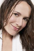 Stock Photo of Portrait of smiling woman with wet hair, studio shot