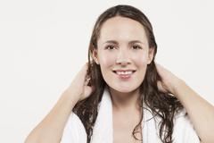 Stock Photo of Portrait of woman with long wet hair, studio shot