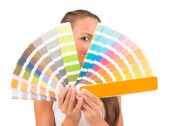 pretty girl between palette of colors - stock photo