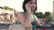 Stock Video Footage of woman receives a call on his cell phone , near roman forum - steadycam