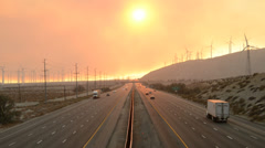 Traffic on Highway with Fire Smoke Sunset Stock Footage