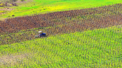 Tractor working on a field. Stock Footage