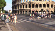 Stock Video Footage of turists on a pedestrian crossing in front of coliseum - slow motion