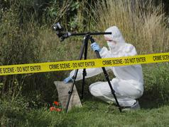 Crime scene examination Stock Photos