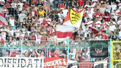 Soccer fans at the stadium. Fans of football team VfB Stuttgart Stock Footage