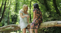 Two girl friends laughing and talking in the park HD Footage