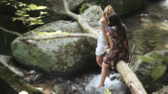 Beautiful sad woman confides his problems to a friend - near stream Stock Footage