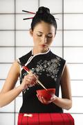 Stock Photo of chinese girl wuth food