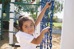 Stock Photo of USA, California, Portrait of girl (4-5) climbing at playground