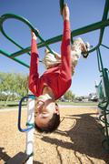 Stock Photo of USA, California, Boy (12-13) climbing at playground