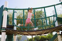 Stock Photo of USA, California, Girl (4-5) playing in playground