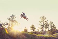 USA, Texas, Austin, Dirt bike jumping Stock Photos