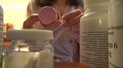 Woman takes pills at home, cabinet, pharmaceutical drugs, overdose - stock footage