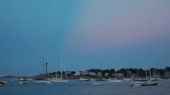 Stock Video Footage of Boats in Harbor at Magic Hour