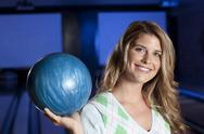 Young smiling woman holding bowling ball Stock Photos