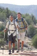 USA, Arizona, Sedona, Young men hiking in desert Stock Photos