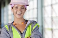 Stock Photo of Portrait of female manual worker wearing hardhat