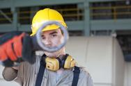 Stock Photo of Portrait of male manual worker holding tool