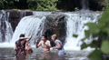 girls of boys have fun in a river - dancing, hugging and playing with water Footage