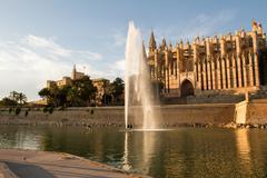royal palace of la almudaina and cathedral la seu - stock photo