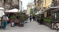 Bucharest city street, old town street with restaurant and pub, Romania Stock Footage