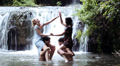 boys and girls are having fun in a river, struggling and splashing with water HD Footage