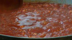 Boiling bolognese sauce in a saucepan, italian cuisine, tomato sauce Stock Footage