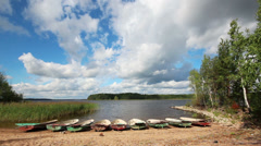 Landscape with boats on lake Stock Footage