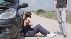 Young man helps a woman who has the car broke down Stock Footage