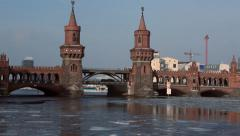 Berlin The Spree river in Winter pan up to Oberbaum bridge  Stock Footage