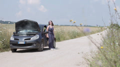 Broken down car on a country road Stock Footage