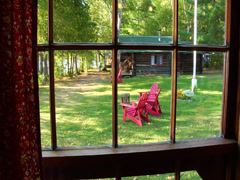 Adirondack chairs on lawn - stock footage