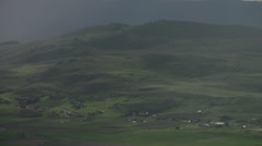 Time-lapse clouds, shadows, mist and green hills, late afternoon into dark. Stock Footage