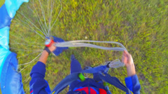 Paratrooper parashute collects Stock Footage