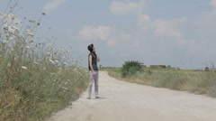 desperate hitchhiker on country road - stock footage