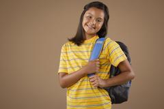 Studio portrait of girl (10-11) wearing backpack Stock Photos