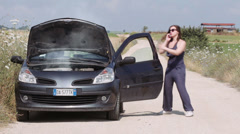 Woman seek for emergency services,because the car is broke Stock Footage