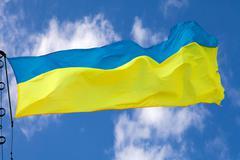 Ukrainian flag waving on cloudy sky Stock Photos