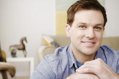 Portrait of smiling mid adult man - stock photo