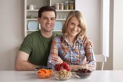 Stock Photo of Portrait of mid adult woman with healthy fruits