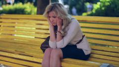 Head ache problem depression sad young business woman in park, click for HD Stock Footage