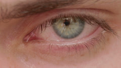 opening and closing of one eye of young man  very sad - tears - allergy - stock footage