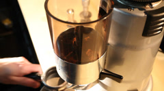 Bartender grinds beans in coffee mill Stock Footage