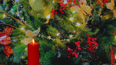 Red candle with  red berries and Christmas decorations Stock Footage