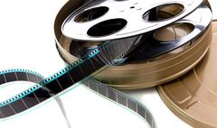 film strip, reel and can - stock photo