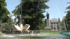 University of Dushanbe behind Rudaki statue and fountain Stock Footage