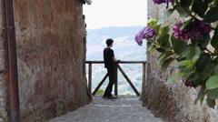 Pensive man looks at a beautiful Italian landscape Stock Footage