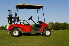 a red golf cart or buggy - stock photo