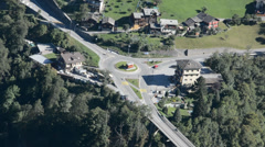 Traffic on a roundabout in a small Swiss mountain village Stock Footage